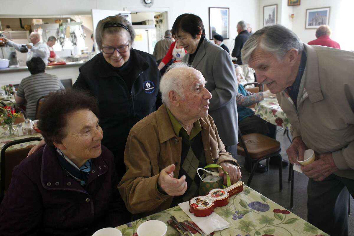 Faina Burovaya, left and husband Roman Shatsov, meet with friends Klava Motoviloff, back, and Vsevolod Kolesnikoff during lunch at the Russian American Community Services, Tuesday April 15, 2014, in San Francisco, Calif.