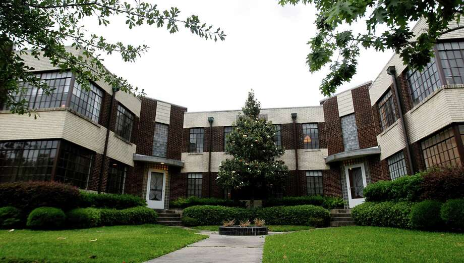 Exterior of the Josephine Apartments near Rice University, Friday, May 9, 2014, in Houston. The complex is home to eight tenants. The landlord, who has owned the 1930s Art Deco complex for decades, sold the apartments to Tricon Builders, which is considering demolishing the apartments to build single family homes. ( Karen Warren / Houston Chronicle  ) Photo: Karen Warren, Staff / © 2014 Houston Chronicle