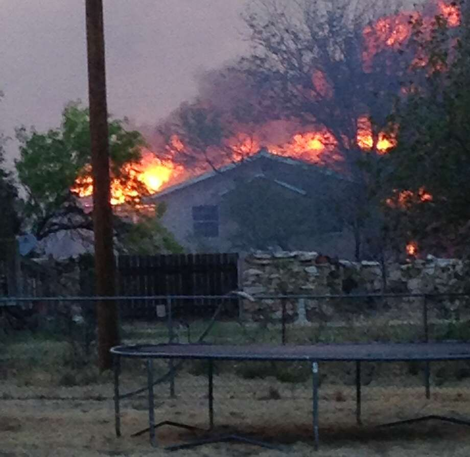 In this Sunday, May 11, 2014 photo provided by the Texas Department of Public Safety, a wildfire burns near Fritch, Texas. The wildfire has led to evacuations and road closures and has destroyed dozens of homes. (AP Photo/Texas Department of Public Safety, Chris Ray) Photo: Trooper Chris Ray, Associated Press