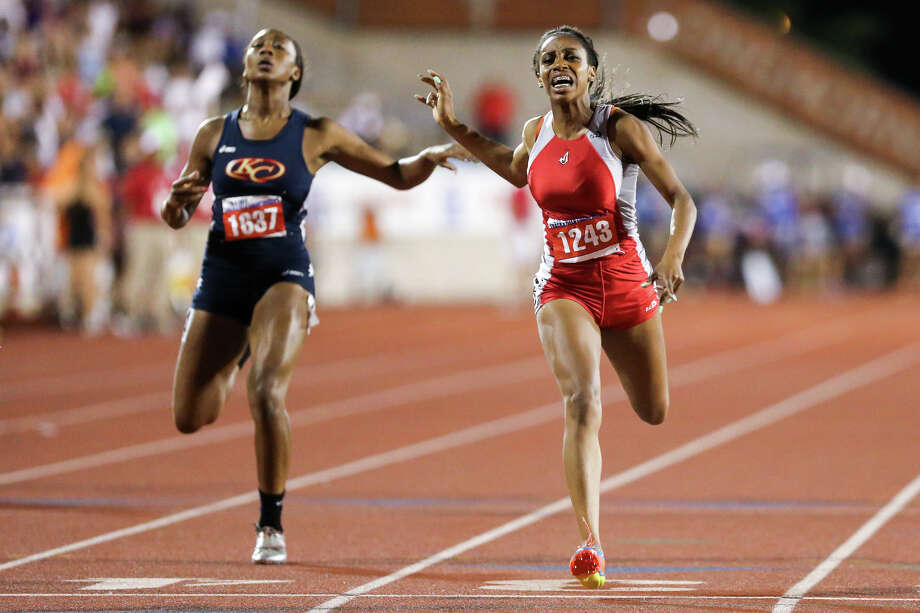 Judson's Kiana Horton (right) crosses the finish line ahead of Klein Collins' Taylor Bennett in the Class 5A 200-meter run Saturday during the UIL State track meet at Mike Myers Stadium in Austin. Horton finished second in the event with a time of 23.81 seconds. Photo: MARVIN PFEIFFER, Marvin Pfeiffer/ Northeast Herald / Express-News 2014