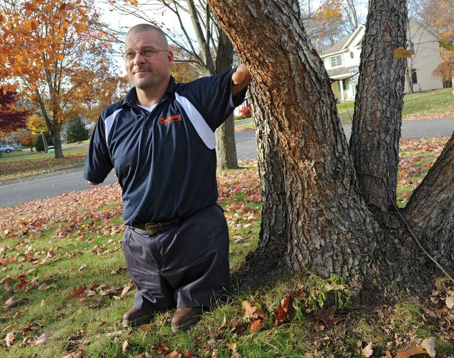 Athlete and an inspirational and motivational speaker John Robinson stands in his front yard on Tuesday, Nov. 5, 2013 in Delmar, N.Y.  (Lori Van Buren / Times Union) ORG XMIT: MER2013110516374027 Photo: Lori Van Buren / 00024497A