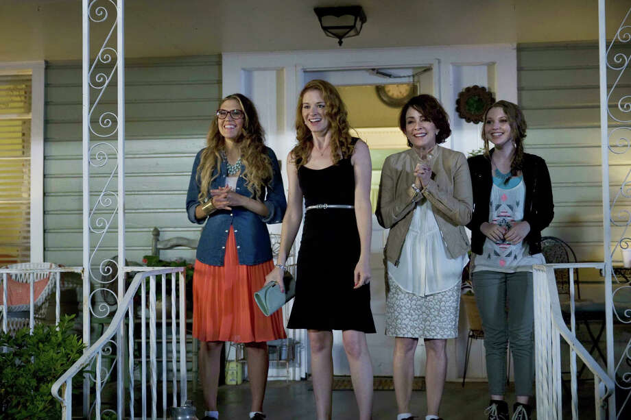 Izzy (Andrea Logan White), Allyson (Sarah Drew), Sondra (Patricia Heaton) and Zoe (Sammi Hanratty) share good news with the search-and-rescue party in MOMS? NIGHT OUT, the new family comedy from Sony Affirm and Provident Films, in theaters May 9, 2014. (photo credit: Saeed Adyani)