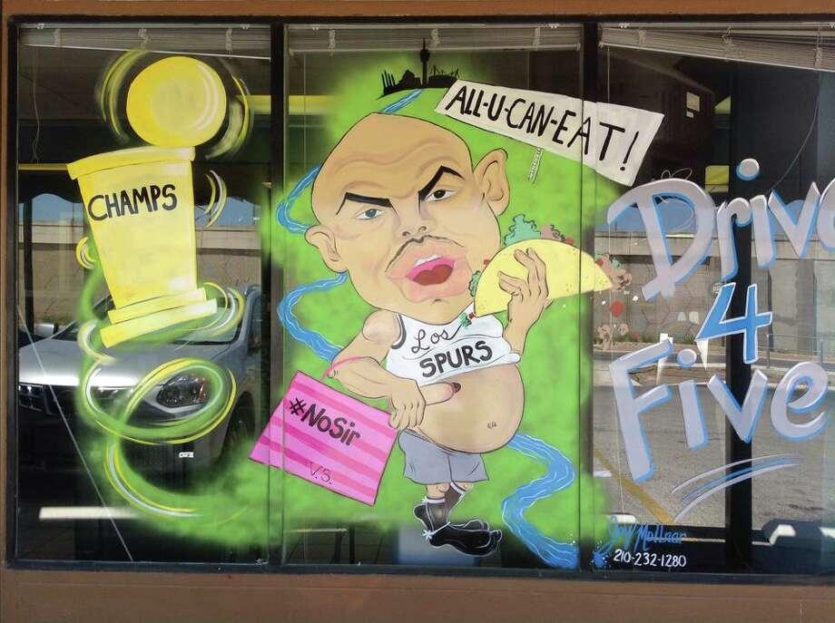 Mural painted on San Pedro Ave beauty salon pokes fun at Charles Barkley Photo: Joy Mollnar
