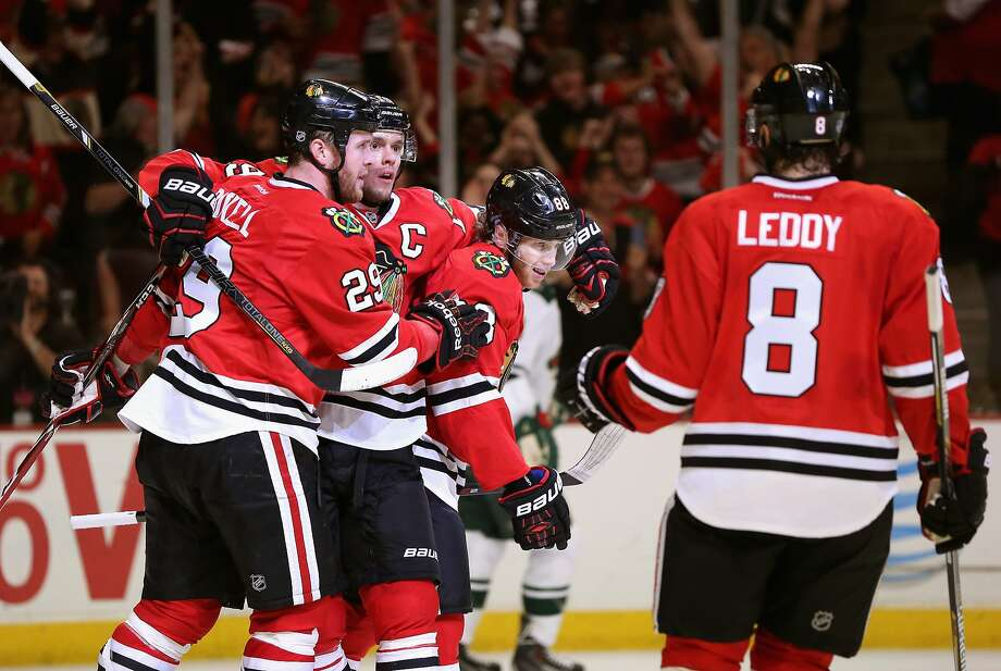 CHICAGO, IL - MAY 11:  (L-R) Bryan Bickell #29, Jonathan Toews #19, Partick Kane #88 and Nick Leddy #8 of the Chicago Blackhawks celebrate Bickell's second period goal against the Minnesota Wild in Game Five of the Second Round of the 2014 NHL Stanley Cup Playoffs at the United Center on May 11, 2014  in Chicago, Illinois. The Blackhawks defeated the Wild 2-1. (Photo by Jonathan Daniel/Getty Images) Photo: Jonathan Daniel, Getty Images