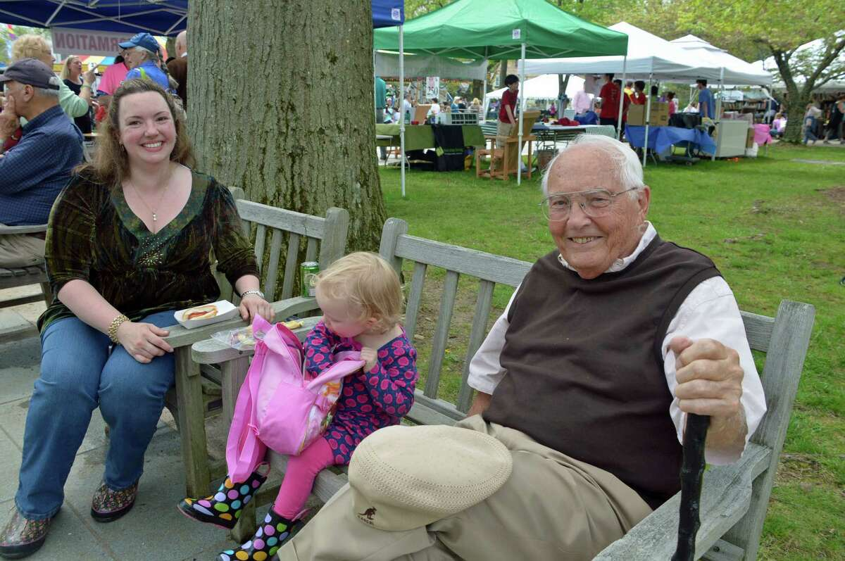 The annual May Fair, which concluded its 65th year Saturday, May 10, has been a destination for many over the years, including, from left, Debbie Shields Runestad, of Wilton, who grew up in New Canaan; her daughter, Gwendolyn, 2; and her great-grandfather Dean Stoakes, 91, of Florida and Oregon. Jarret Liotta / For the New Canaan News