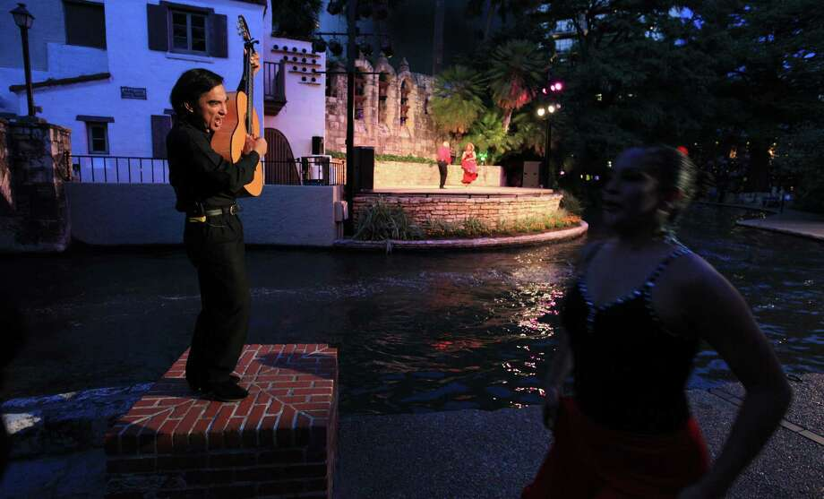 Alejandro Antonio performs during the 57th season of Fiesta Noche del Rio at the Arneson River Theatre last year. This year, the event kicks off at 8:30 p.m. Friday, May 16. Photo: Express-News File Photo / © 2013 San Antonio Express-News
