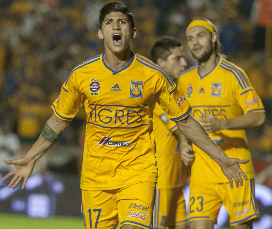 The Tigres' Alan Pulido celebrates after scoring  during the 2014 Mexican Clausura tournament in Monterrey, Mexico. The Tigres will play the Scorpions June 21 at Toyota Field. Photo: AFP / Getty Images / AFP