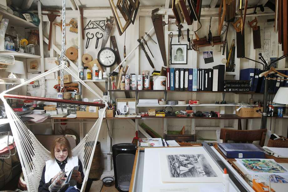 Jayne Oldfield Blatchly, daughter of San Francisco artist Otis Oldfield, hangs out in her father's old studio. Oldfield was recruited to help paint the famous murals at Coit Tower, which reopens Wednesday. Photo: Leah Millis, San Francisco Chronicle
