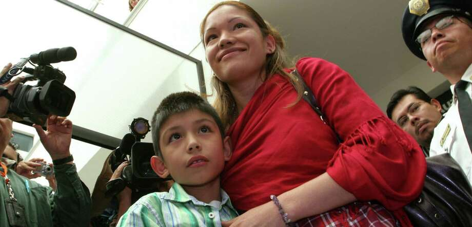 In 2007, Elvira Arellano and her U.S.-born son arrive in Mexico City. Arellano was deported after living for a year in a Chicago church. Back in the U.S. seeking asylum, Arellano now speaks out for immigration reform and a halt to deportations. Photo: Associated Press File Photo / AP