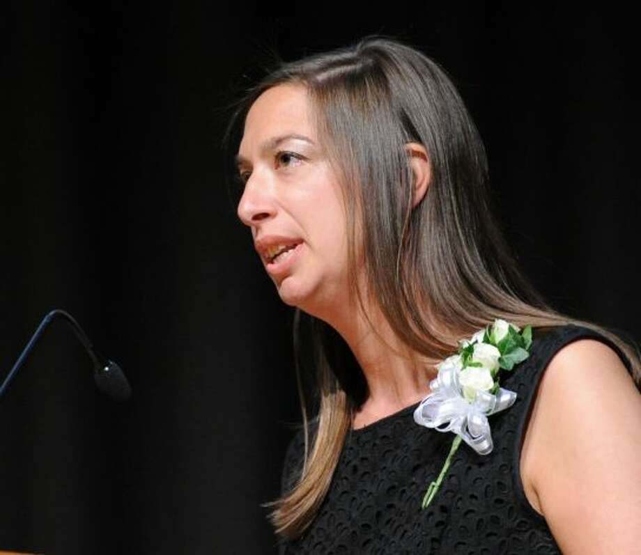 Mara Adelsberg delivers her acceptance speech at the Distinguished Teachers Awards ceremony May 6 at Central Middle School