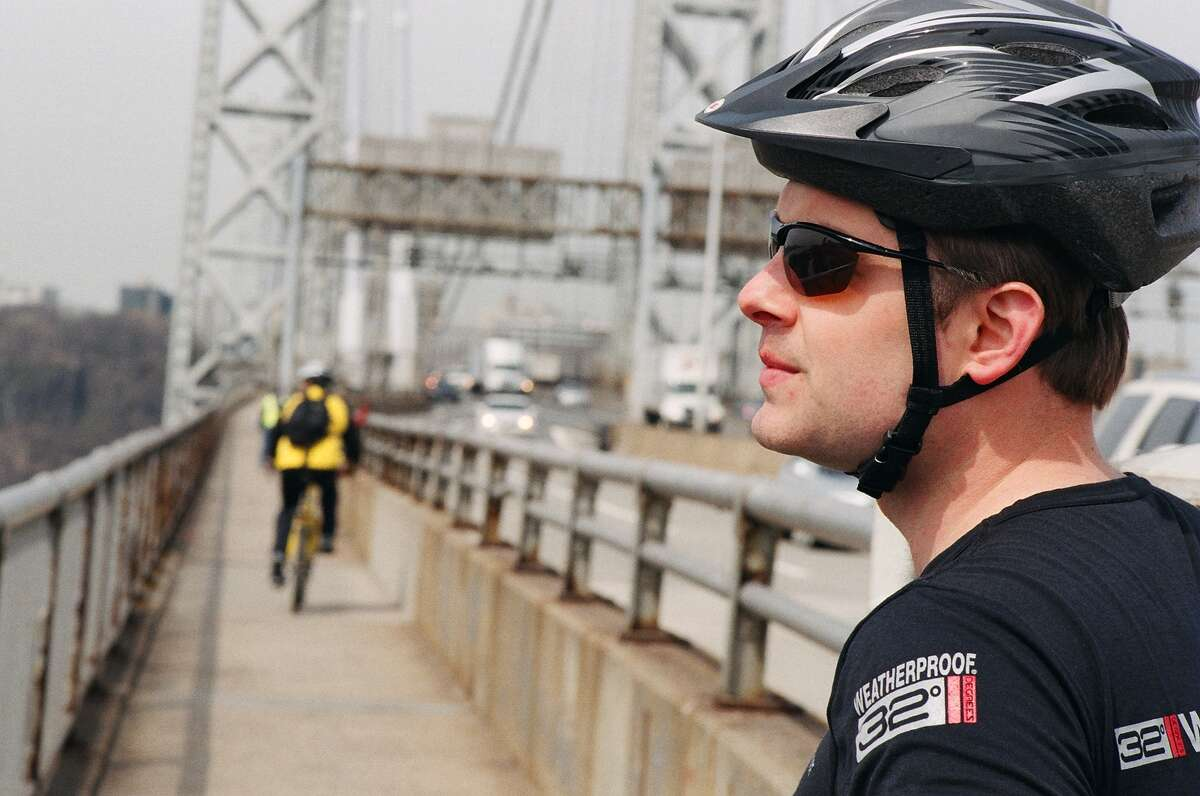 Chandler Wild leaves New York City on the George Washington Bridge on day one of his five-month bike trip across the continent.