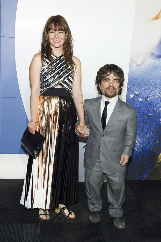 "Peter Dinklage, right, and Erica Schmidt attend the ""X-Men: Days of Future Past"" world premiere on Saturday, May 10, 2014, in New York. Photo: Charles Sykes, Associated Press"