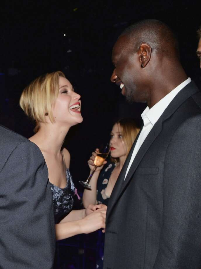 "Actors Jennifer Lawrence (L) and Omar Sy attend the ""X-Men: Days Of Future Past"" after party at SIR Stage37 on May 10, 2014 in New York City. Photo: Mike Coppola, Getty Images"