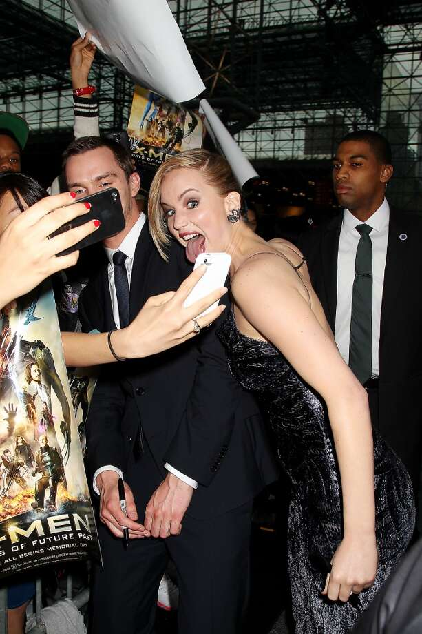 "In this Saturday, May 10, 2014 photo released by Starpix, actors Jennifer Lawrence, center, and Nicholas Hoult, left, mug for a fans' mobile phone cameras during the premiere of ""X-Men: Days of Future Past,"" in New York. Photo: Dave Allocca, Associated Press"