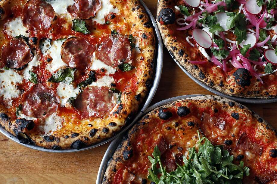 The Scotty 2 Hottie (left), the Cortez and the Commissioner Gordon are among the daily pizzas at Oak & Rye in Los Gatos. Photo: Sarah Rice, Special To The Chronicle