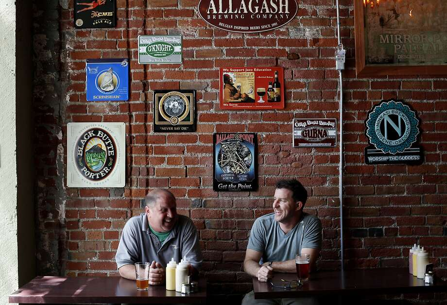 JD Stager, right, and Dave Dorman have a beer at the Original Gravity Public House in San Jose, Calif., on Friday, May 2, 2014. Photo: Sarah Rice, Special To The Chronicle