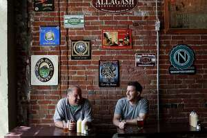JD Stager, right, and Dave Dorman have a beer at the Original Gravity Public House in San Jose, Calif., on Friday, May 2, 2014.