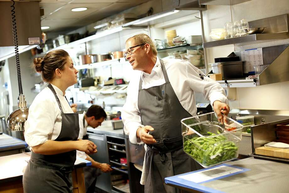 David Kinch, chef and owner at Manresa in Los Gatos, works in the kitchen with chef de cuisine Jessica Largey. Photo: Sarah Rice, Special To The Chronicle