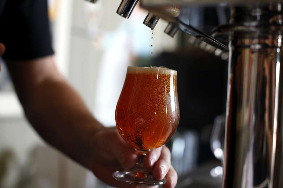 Joel Wind pours a Citra IPA at Hermitage Brewing Company in San Jose, Calif., on Friday, May 2, 2014. Photo: Sarah Rice, Special To The Chronicle