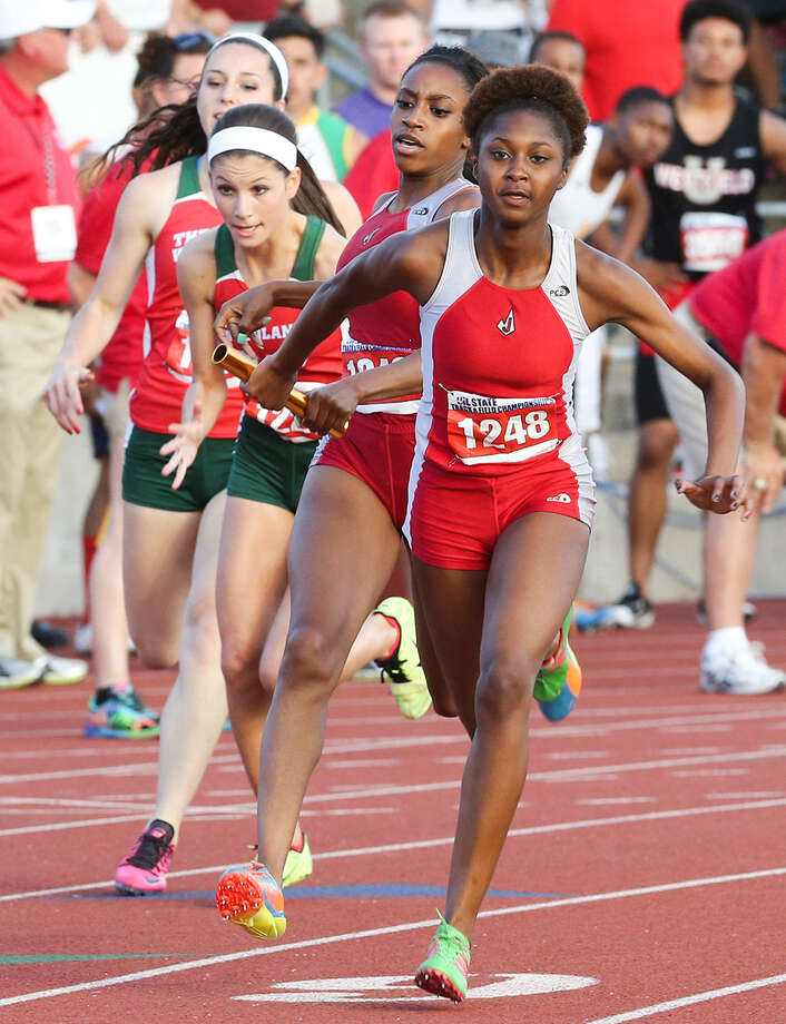 Judson's Ariel Watson (right) takes the handoff from Kiana Horton on the third leg of the 5A 800-meter relay Saturday during the UIL state track meet in Austin. Photo: Marvin Pfeiffer/ Northeast Heral / Express-News 2014