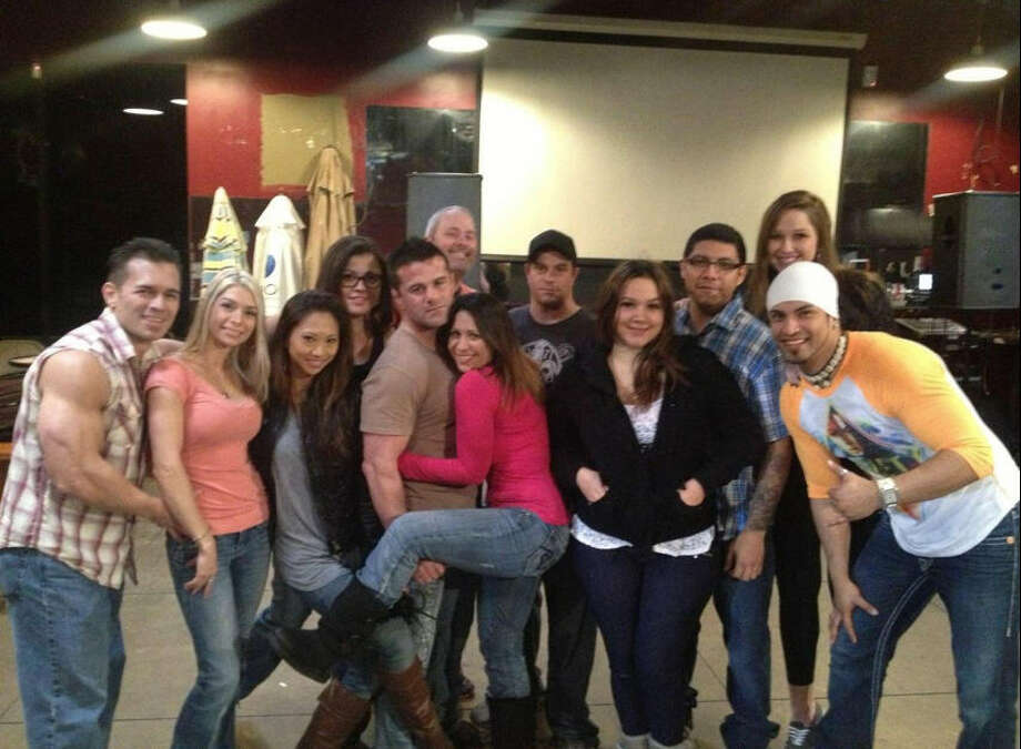 "A group shot of Houston Sports Hub (formerly The End Zone) employees. The bar was recently featured on Spike TV's ""Bar Rescue."""