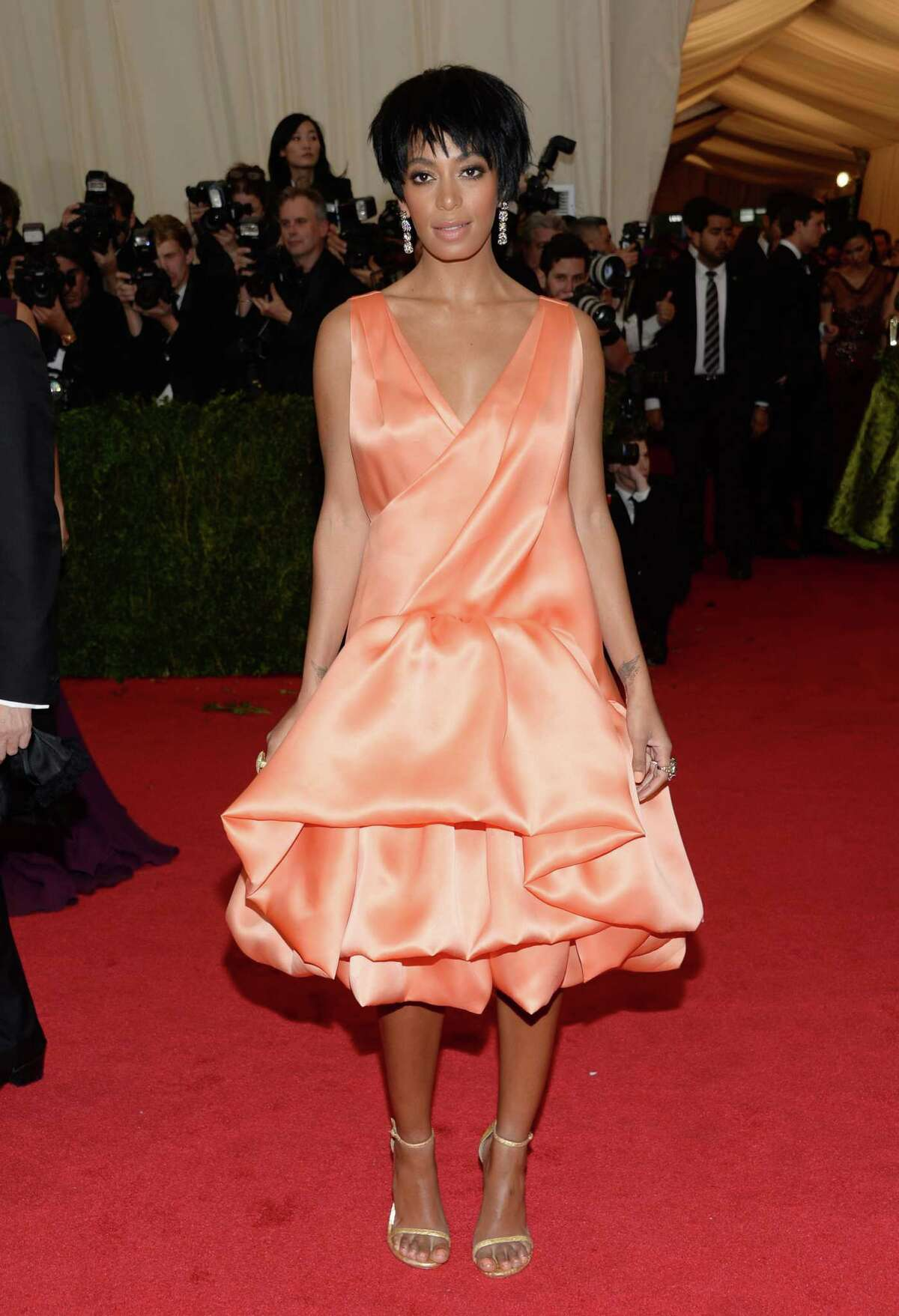 """FILE - This May 5, 2014 file photo shows Solange Knowles, sister of Beyonce Knowles, at The Metropolitan Museum of Art's Costume Institute benefit gala celebrating """"Charles James: Beyond Fashion"""" in New York. The Standard Hotel in New York City says it is investigating the leak of a security video that appears to show Beyonce's sister, Solange, attacking Jay Z. Asked about the video on Monday, May 12, by The Associated Press, the hotel issued a statement saying it is """"shocked and disappointed that there was a clear breach of our security system."""" (Photo by Evan Agostini/Invision/AP)"""
