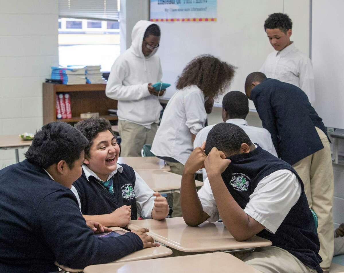 Seventh-graders Daniel Aguilar, left, Devin Sampson and Henry Sanchez play a game and relax after finishing the Stanford Achievement Test.