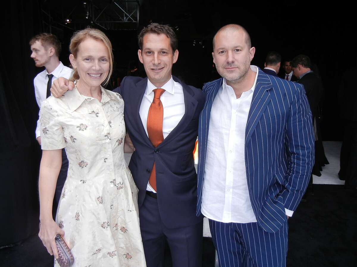 TIpping Point benefit co-chair Heather Ive (left) with TP founder-CEO Daniel Lurie and her husband, Apple designer Sir Jony Ive at Pier 48. May 2014. By Catherine Bigelow.
