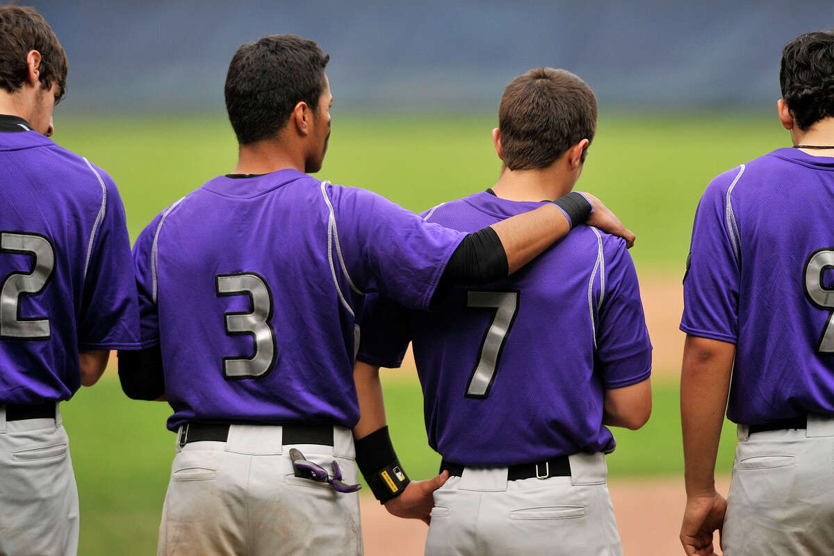 Westhill's Randy Barahona (3) puts his arm around Cameron Curto during a moment of silence for Curto's father who died recently before their baseball game against Stamford at Cubeta Stadium at Scalzi Park in Stamford, Conn., on Monday, May 12, 2014. Westhill won, 3-2.