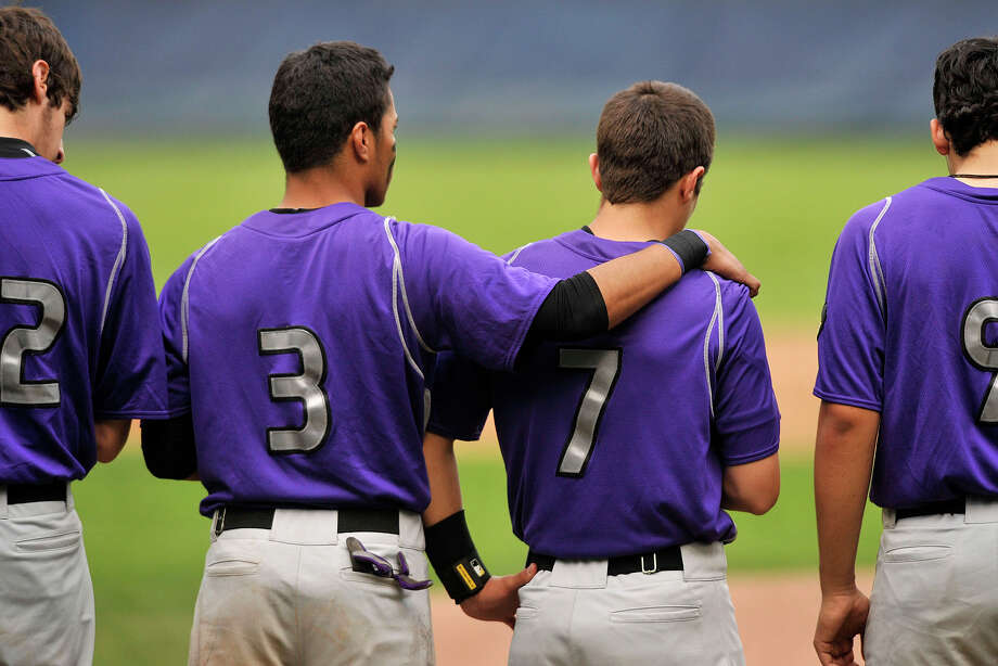 Westhill's Randy Barahona (3) puts his arm around Cameron Curto during a moment of silence for Curto's father who died recently before their baseball game against Stamford at Cubeta Stadium at Scalzi Park in Stamford, Conn., on Monday, May 12, 2014. Westhill won, 3-2. Photo: Jason Rearick / Stamford Advocate
