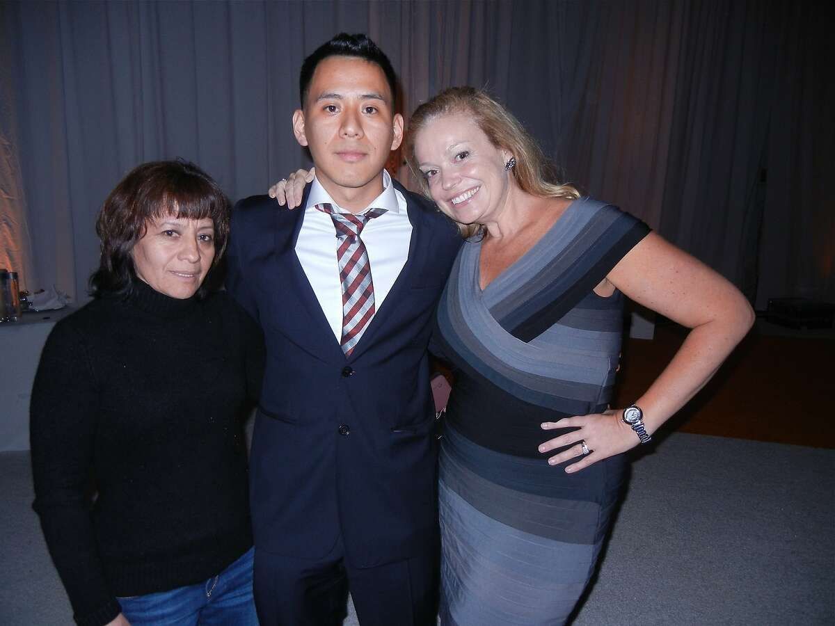 Maria Sanchez (left) with her son, UC Davis student Carlos Romero and Build.org founder Suzanne McKechnie Klahr at the Tipping Point Benefit. May 2014. By Catherine Bigelow.