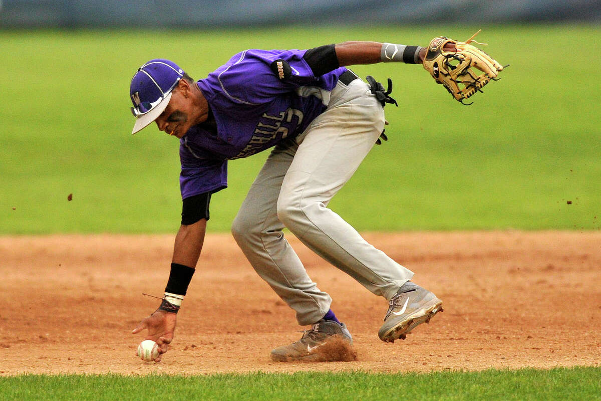 Westhill shortstop Ronald Jackson barehands a ball before firing to first during the Vikings' baseball game against Stamford at Cubeta Stadium at Scalzi Park in Stamford, Conn., on Monday, May 12, 2014. Westhill won, 3-2.