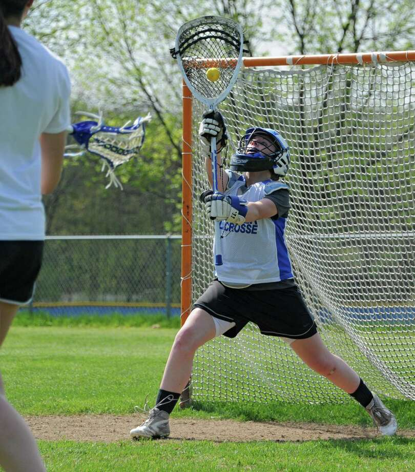 Shaker lacrosse goalie Julia Maloney practices with her team Monday, May 12, 2014, in Latham, N.Y.  (Lori Van Buren / Times Union) Photo: Lori Van Buren / 00026856A