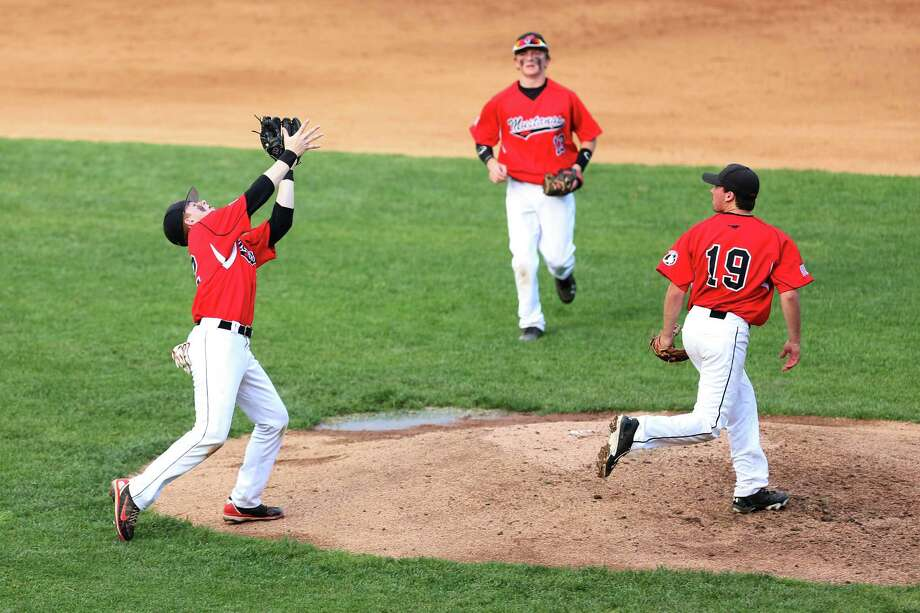 Fairfield Warde's # 22 Zach Weinstein successfully catches a pop-up to the pitcher's mound as team mates #13 Dakota DeJordy and #19 Nick Nardone look on during Monday evenings match-up against Fairfield Ludlowe at Harbor Yard in Bridgeport. Photo: Mike Ross / Mike Ross Connecticut Post freelance - @www.mikerossphoto.com