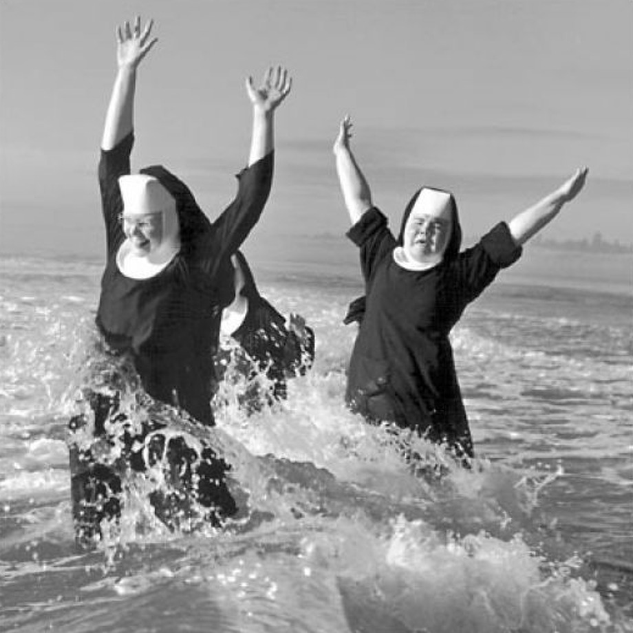 "While ""it's gravity keeps us from drifting lifeless and cold through space"" (as one colleague quipped) … it's the sun that we worship.  Photo: Childlike glee takes flight when a trio of nuns from the Order of St. Benedict make a splash in the Pacific Ocean while vacationing at Grayland in 1960. The photographer was Tom Brownell. Credit SEATTLE POST-INTELLIGENCER"