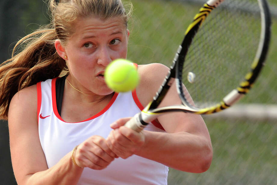 Greenwich's Anna Daccache returns the ball to Fairfield Ludlowe's Lindsey Evans during their tennis match at Greenwich High School in Greenwich, Conn., on Monday, May 12, 2014. Photo: Jason Rearick / Stamford Advocate