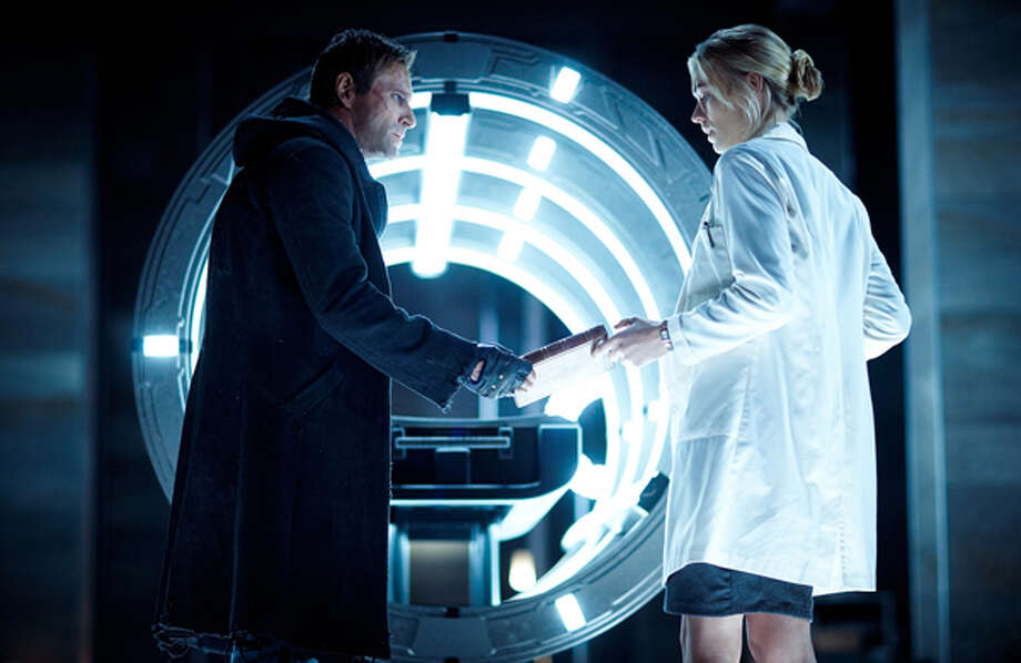 "Aaron Eckhart as Adam and Yvonne Strahovski  as Terra in ""I, Frankenstein."" Photo: Lionsgate Home Entertainment, 2014"