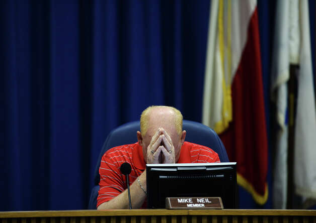 Board member Mike Neil rubs his forehead before the beginning of Monday's sparsely attended public hearing regarding the district's accreditation. The Beaumont Independent School District board of trustees held their agenda review meeting on Monday night.