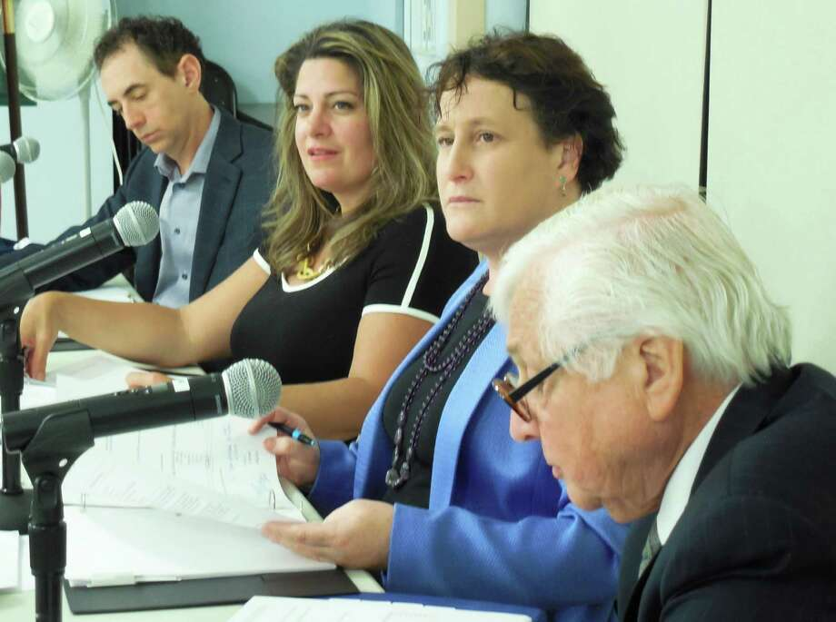 Board of Education members met Monday night to vote its final approval of its 2014-15 school budget and to discuss projected capital costs for school security. From left are BOE members Michael Gordon; Jeannie Smith, vice chairwoman; and Elaine Whitney, chairwoman. At far right is Superintendent of Schools Elliot Landon. Photo: Anne M. Amato / westport news