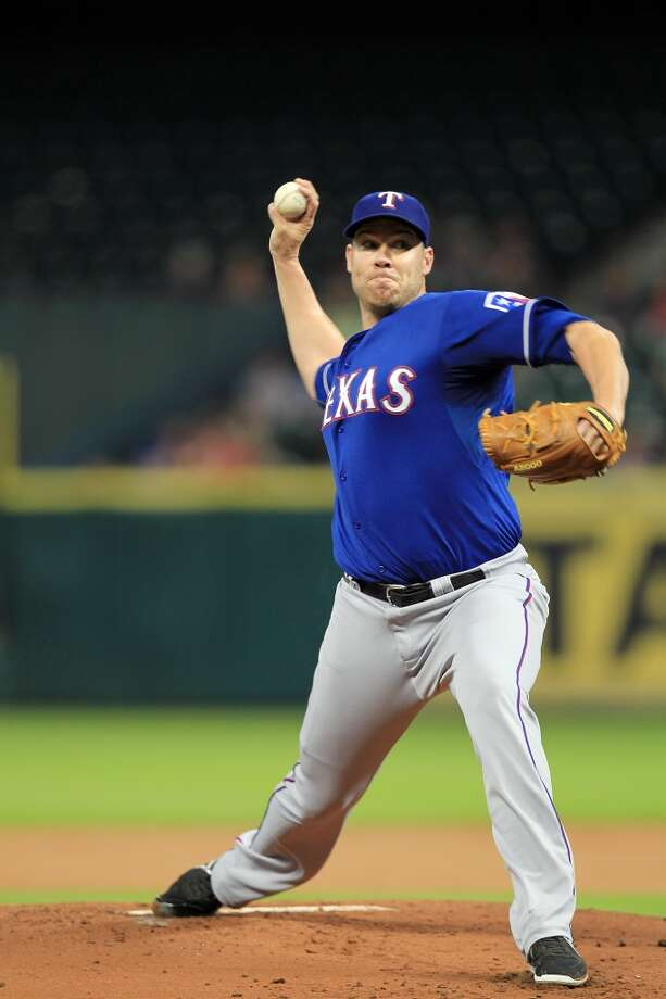 Colby Lewis pitches in the first inning. Photo: Mayra Beltran, Houston Chronicle