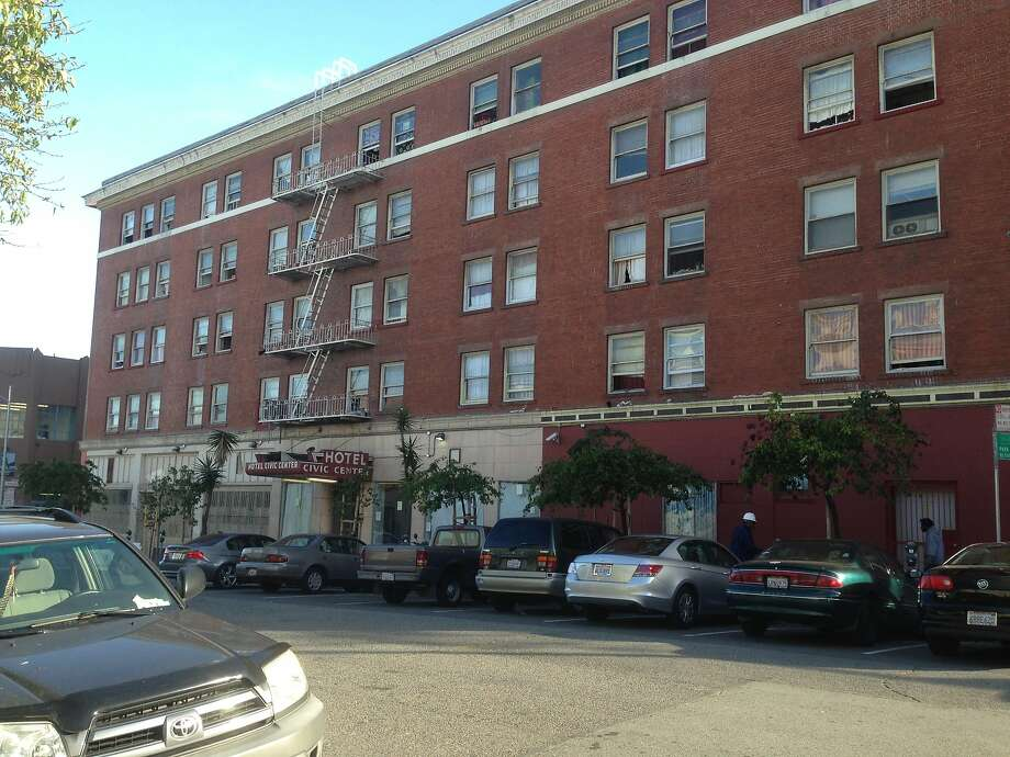 The Civic Center Hotel at 20 12th St. in the South of Market neighborhood in San Francisco. The residential hotel is one of several owned or controlled by the Thakor family. San Francisco City Attorney Dennis Herrera filed a lawsuit on Monday, May 12, 2014, accusing four members of the Thakor family and 13 different companies they allegedly control of defrauding the city by providing unsafe housing in violation of their city contract. Photo: David De La Fuente, San Francisco Chronicle