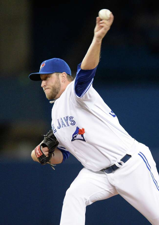Toronto Blue Jays starting pitcher Mark Buehrle pitches against the Los Angeles Angels during first inning American League baseball action in Toronto on Monday, May 12, 2014. (AP Photo/The Canadian Press, Frank Gunn) ORG XMIT: FNG703 Photo: Frank Gunn / CP