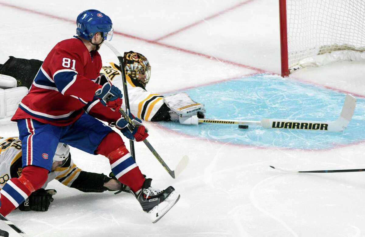 The Canadiens' Lars Eller (81) flicks the puck past Bruins goalie Tuukka Rask during the first period Monday night. Rask stopped 24 shots. The Canadiens' Carey Price turned back 26.