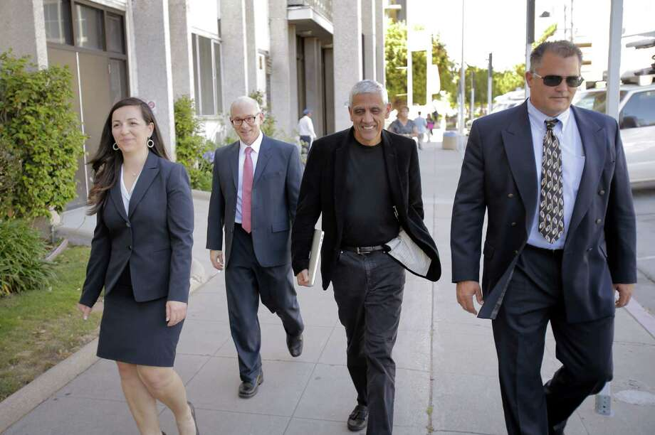 Silicon Valley billionaire Vinod Khosla (center) and his attorneys exit the San Mateo County Superior Court building in Redwood City in May. Photo: Carlos Avila Gonzalez / The Chronicle / ONLINE_YES