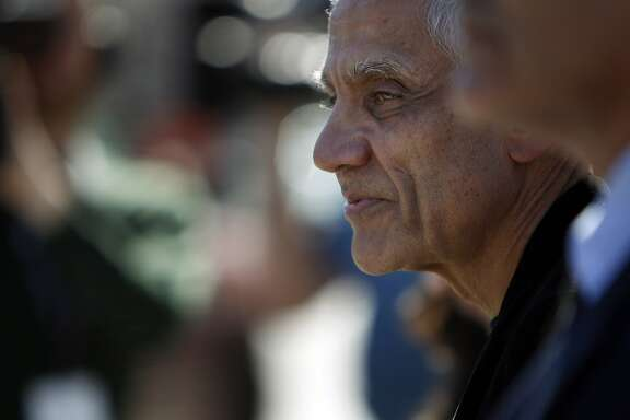 Silicon Valley billionaire Vinod Khosla departs from the San Mateo County Superior Court building with his attorneys in Redwood City, Calif., on Monday, May 12, 2014, after testifying in the Martin's Beach lawsuit.