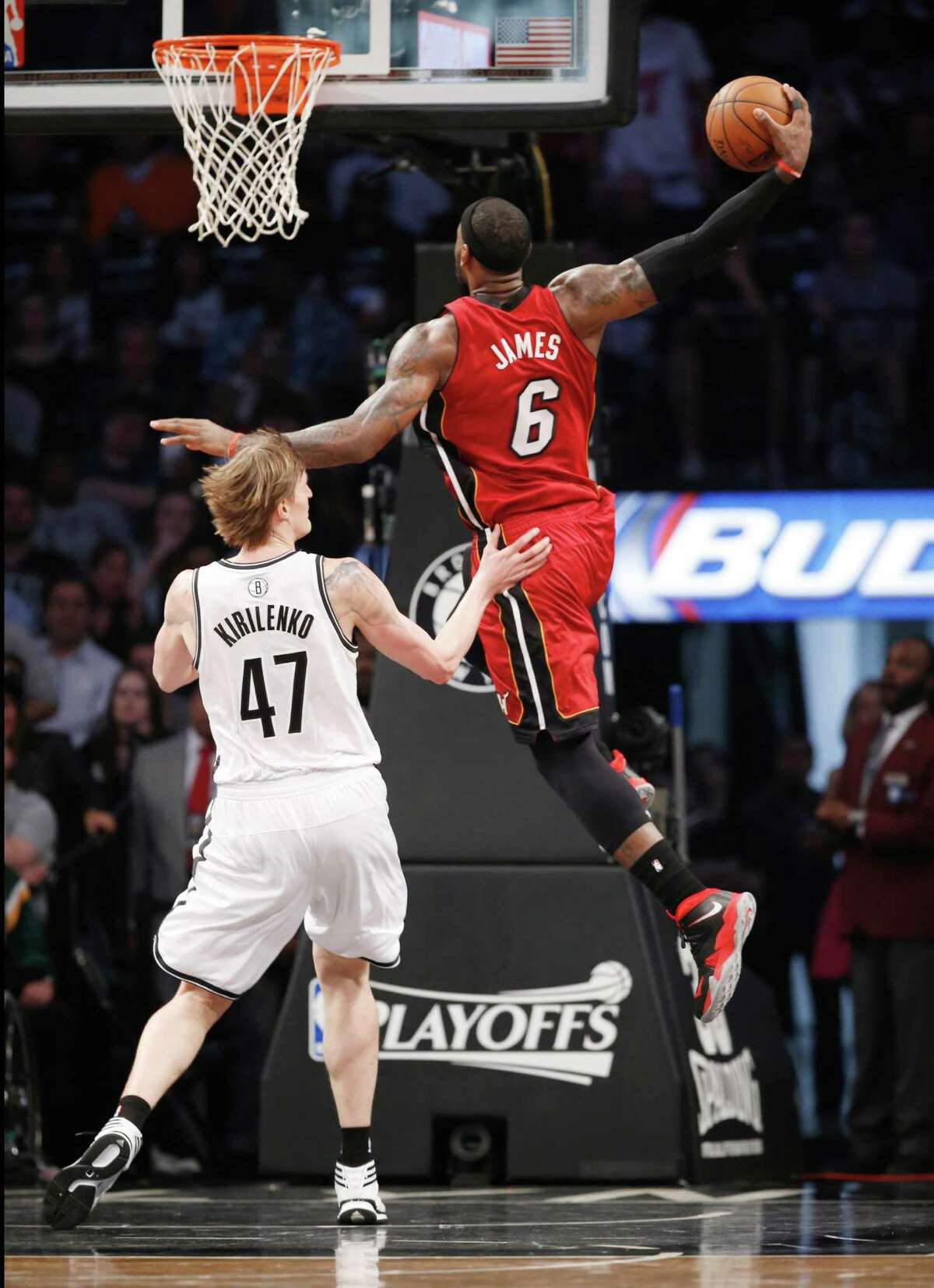 The Heat's LeBron James soars over Nets forward Andrei Kirilenko in the first half. James matched the 49 points he scored with the Cavs in the 2009 playoffs.