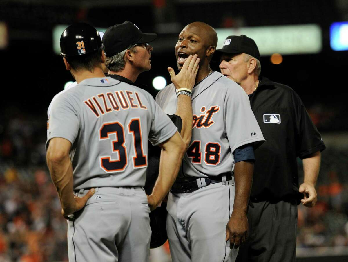 Detroit's Torii Hunter (48) yells toward the Baltimore dugout as umpires try to calm him down after he was hit by a pitch from Orioles pitcher Bud Norris in the eighth inning of the Tigers' 4-1 victory.
