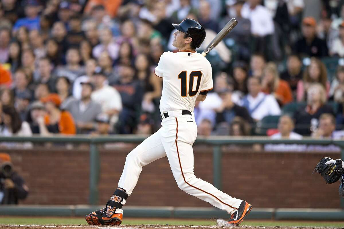 SAN FRANCISCO, CA - MAY 12: Tyler Colvin #10 of the San Francisco Giants hits a home run against the Atlanta Braves during the second inning at AT&T Park on May 12, 2014 in San Francisco, California. (Photo by Jason O. Watson/Getty Images)