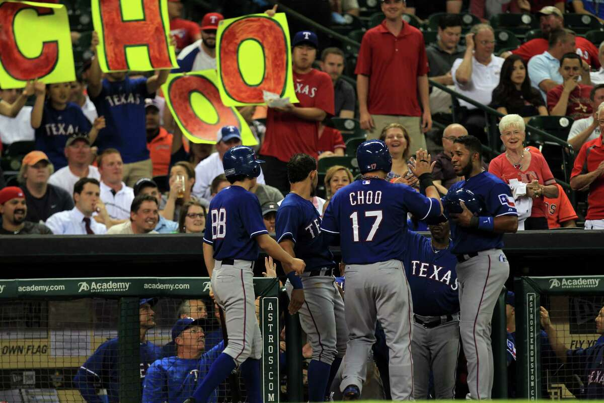 The Rangers' Shin-Soo Choo delights his cheering sections in the dugout and the stands by scoring in the third inning on Adrian Beltre's homer that put the Astros in an insurmountable 2-0 hole.