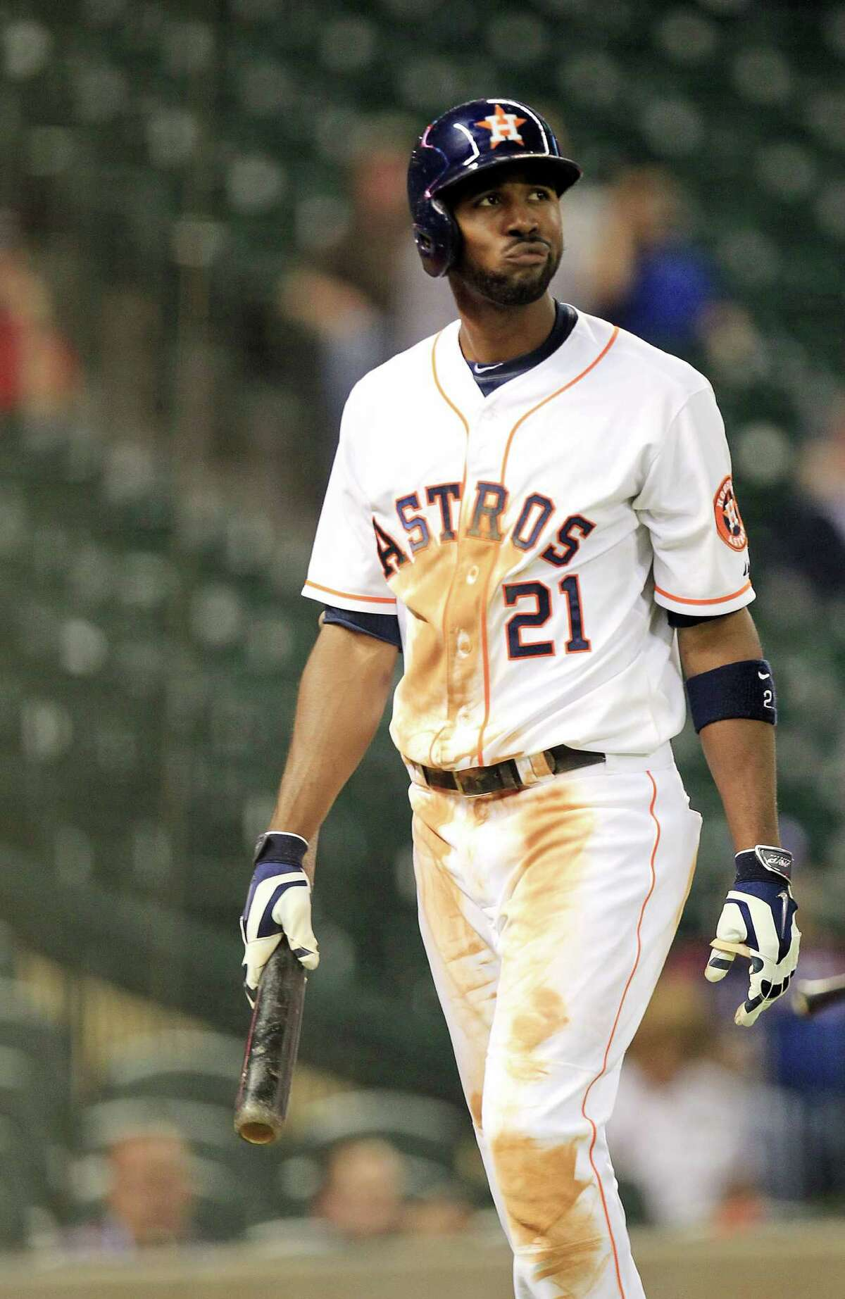 Dexter Fowler returns to the dugout after striking out in the ninth inning, one of 14 strikeouts for the Astros, who left 12 men on base.